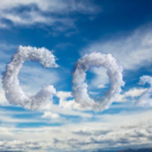 CO2 carbon dioxide pollution sign. Emissions smog cloud symbol on blue cloudy sky background. Planet climate change, global warming concept. 3d illustration